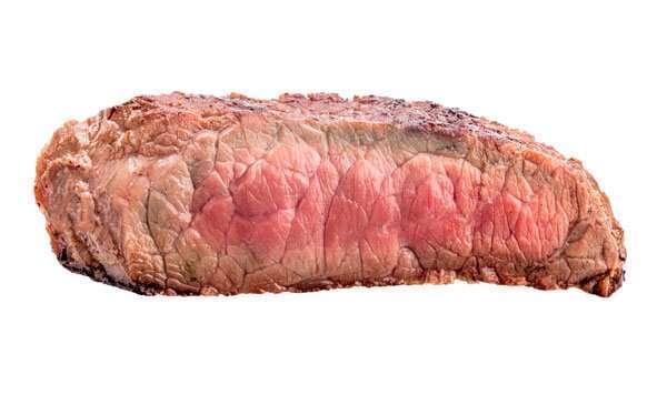 Término medio rojo de la carne